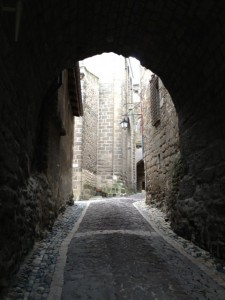 A cobble stone street and alley way in Le Puy en-Velay, France